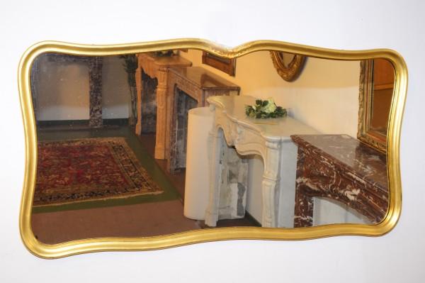 schlichter, goldener spiegel aus dem 20. jahrhundert