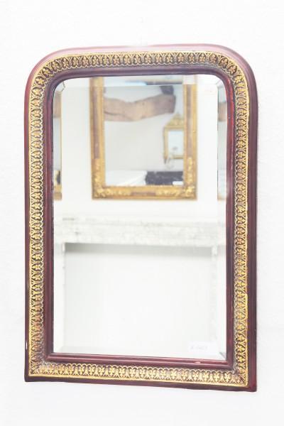 schöner rotbrauner spiegel mit facettenschliff